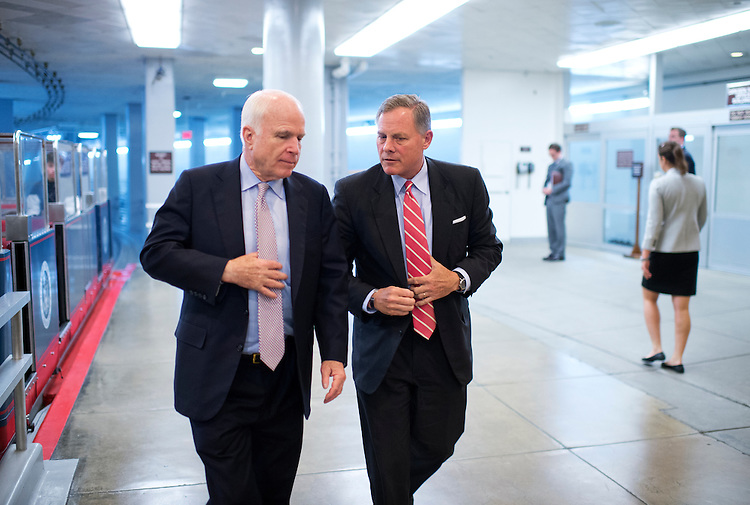 UNITED STATES - MAY 14: Sens. John McCain, R-Ariz., left, and Richard Burr, R-N.C., make their way through the basement of the Capitol en route to a vote in the Senate, May 14, 2014. (Photo By Tom Williams/CQ Roll Call)
