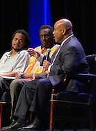 September 8, 2011 (Washington, DC) Panelists take part in breakout session of The Presidential Symposium: Beyond the Stereotypes-Academics, Athletics, Character and Black Male Achievement held at Howard University's Crampton Auditorium.   The symposium, presented by Howard University and Morehouse College, was a day-long discussion that included scholars, students, actors and sports columnists, and preluded the AT&T Nations Football Classic between Howard and Morehouse.  (L-R) Seith Mann, TV and Film Director; Dr. Greg Carr, Associate Professor and Chair, Dept. of African American Studies, Howard University; Jason Reid, Columnist, The Washington Post.   (Photo by Don Baxter/Media Images International)