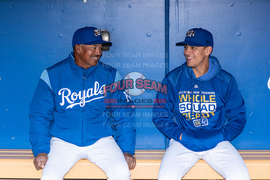 Kansas City Royals roving coach Rafael Belliard talks to Omaha Storm Chasers infielder Nicky Lopez (3) before a Pacific Coast League game against the Memphis Redbirds on April 26, 2019 at Werner Park in Omaha, Nebraska. Memphis defeated Omaha 7-3. (Zachary Lucy/Four Seam Images)