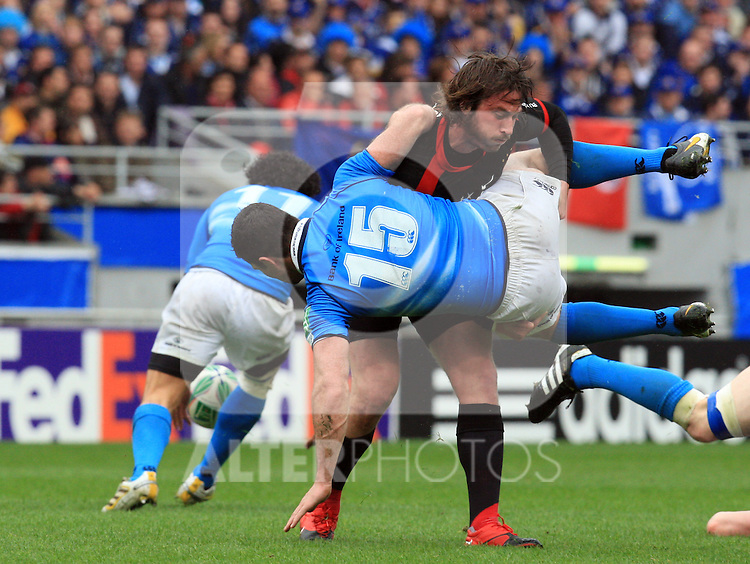 Maxime Medard tackles Rob Kearney during the Heineken Cup semi final match between Stade Toulousain and Leinster at Stade Municipal on May 1, 2010 in Toulouse, France.