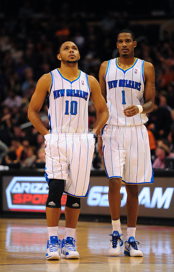 Dec. 26, 2011; Phoenix, AZ, USA; New Orleans Hornets guard Eric Gordon (left) and teammate Trevor Ariza during game against the Phoenix Suns at the US Airways Center. The Hornets defeated the Suns 85-84. Mandatory Credit: Mark J. Rebilas-USA TODAY Sports