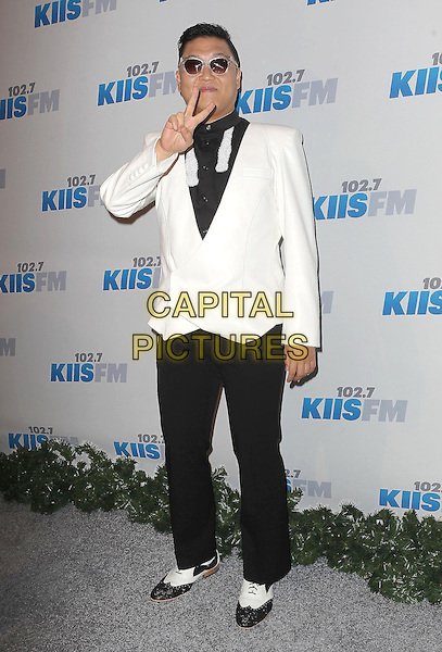 Psy (Park Jae sang).KIIS FM 2012 Jingle Ball - Night 2 held at Nokia Theatre L.A. Live, Los Angeles, California, USA..3rd December 2012 .full length suit jacket trousers white fur tie cream black shirt sunglasses shades hand v peace sign.CAP/ADM/KB.©Kevan Brooks/AdMedia/Capital Pictures.
