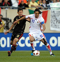 Mexico's Israel Castro pressures Costa Rica's Bryan Ruiz.  Mexico defeated Costa Rica 4-1 at the 2011 CONCACAF Gold Cup at Soldier Field in Chicago, IL on June 12, 2011.