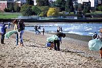 Garbage Clean Up / Cleanup, Kitsilano Beach, Vancouver, BC, British Columbia, Canada - Volunteers picking up Litter at the Annual 'Great Canadian Shoreline Cleanup'