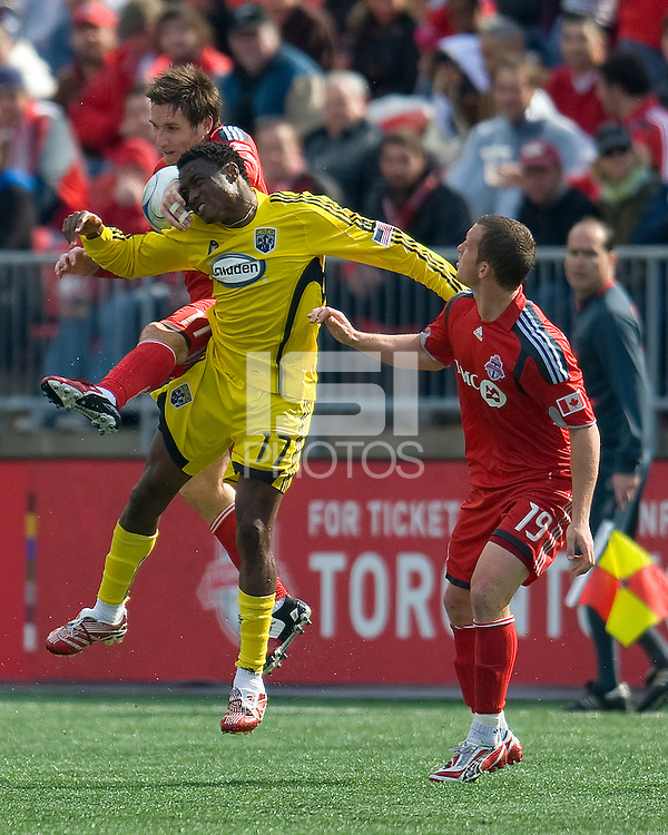 02 May 2009: Columbus Crew midfielder Emmanuel Ekpo #17 and Toronto FC midfielder Jim Brennan #11 jump for a ball as Toronto FC forward Chad Barrett #19 looks on during MLS action at BMO Field in a game between the Columbus Crew and Toronto FC. .The game ended in a 1-1 draw.