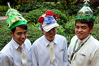 "Manila Street Fashion - Hat Contest - Waiters at this al fresco restaurant in Green Belt Makati hold a hat contest every year during the Chrismtas holidays.  This year's theme is ""recycling"".  Nothing explains the Filipino character better than the word exhuberance.  A passion for costumes, dressing up, funny hats and beauty pageants makes the Philippines a natural when it comes to street fashion.  Although the country's hot, humid climate usually requires casual, comfortable clothing, there is usually a bit of flair added for extra value and fun."