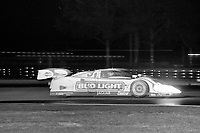 The #3 BudLight Jaguar XJR-12D of Kenny Acheson,  John Nielsen, Raul Boesel, and Davy Jones in action at night duriing the 12 Hours of Sebring, Sebring Raceway, Sebring, FL, March 16, 1991.  (Photo by Brian Cleary/www.bcpix.com)