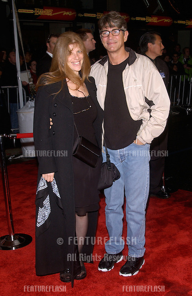 Actor ERIC ROBERTS & wife at the world premiere, in Hollywood, of Miracle..February 2, 2004