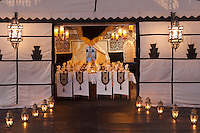 The entrance to the dramatic tented restaurant is lit by candlelight