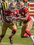 San Francisco 49ers quarterback Colin Kaepernick (7) hands off ball to running back Mike Davis (22) for touchdown play on Sunday, October 23, 2016, at Levis Stadium in Santa Clara, California. The Buccaneers defeated the 49ers 34-17.