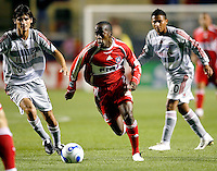 Chicago Fire midfielder Thiago (11) dribbles down the field as FC Dallas midfielders Pablo Ricchetti (6) and Ramon Nunez (10) look on.  FC Dallas defeated the Chicago Fire 2-1 at Toyota Park in Bridgeview, IL on May 17, 2007.