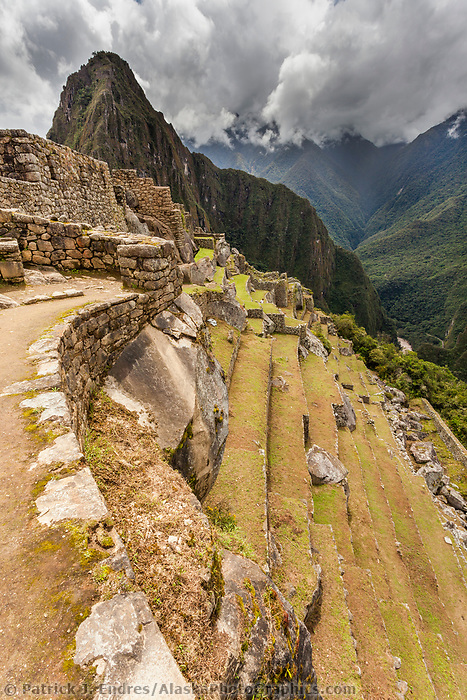 "Peak of Huaynapicchu (young mountain) in the distance. Machu Picchu, the ancient ""lost city of the Incas"", 1400 CA, 2400 meters.  Discovered by Hiram Bingham in 1911. One of Peru's top tourist destinations."