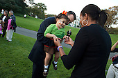 Washington, DC - October 9, 2009 -- First Lady Michelle Obama greets a young girl during the United States Secret Service Presidential Protective Division autumn picnic on the South Lawn of the White House, October 9, 2009. .Mandatory Credit: Samantha Appleton - White House via CNP