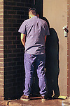 © Joel Goodman - 07973 332324 . No syndication permitted . 01/01/2014 . Manchester , UK .A man urinates against a door . Revellers see in the New Year in Manchester today (January 1st 2014) as police report that officers are at full stretch responding to calls . Photo credit : Joel Goodman