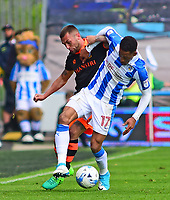 Sheffield Wednesday's Jack Hunt vies for possession with Huddersfield Town's Rajiv van La Parra<br /> <br /> Photographer Andrew Vaughan/CameraSport<br /> <br /> The EFL Sky Bet Championship Play-Off Semi Final First Leg - Huddersfield Town v Sheffield Wednesday - Saturday 13th May 2017 - The John Smith's Stadium - Huddersfield<br /> <br /> World Copyright &copy; 2017 CameraSport. All rights reserved. 43 Linden Ave. Countesthorpe. Leicester. England. LE8 5PG - Tel: +44 (0) 116 277 4147 - admin@camerasport.com - www.camerasport.com