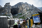 The revered Hindu pilgrimage, the Amarnath yatra ends at the Holy Cave (13500ft) in Kashmir, India. Hindu pilgrims brave sub zero temperature and high latitude passes and make their pilgrimage to reach the sacred Amarnath cave, which houses a lingam - a stylized phallus, worshiped by Hindus as a symbol of God Shiva. Photo: Sanjit Das/Panos