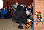 John Greig lays a wreath on behalf of Rangers