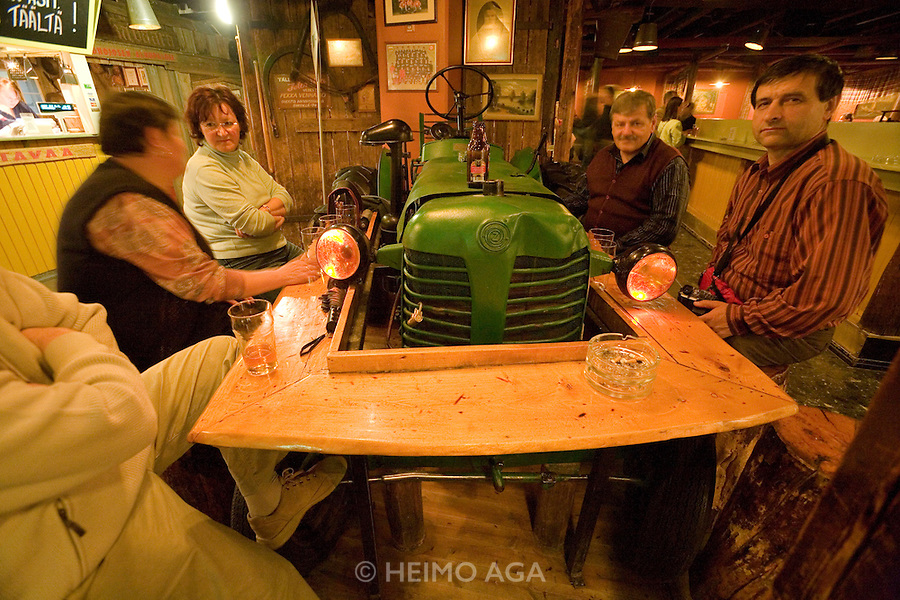 "Zetor, a cult Finnish restaurant and bar owned by famous Finnish rock group ""Leningrad Cowboys"", features 5 original Czech Zetor tractors used as tables."