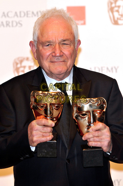 DAVID SEIDLER .At the 2011 Orange British Academy Film Awards (BAFTAs), Royal Opera House, Covent Garden, London, England, UK, February 13th 2011..press room half length awards winner trophies black suit tie .CAP/PL.©Phil Loftus/Capital Pictures.