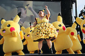 """August 12, 2016, Yokohama, Japan - Japanese actress and comedienne Naomi Watabe (C) dances with Pikachu characters, Nintendo's videogame software Pokemon's wellknown character at a show """"Super Soaking Splash Show"""" in Yokohama, suburban Tokyo on Friday, August 12, 2016. The Pikachu mascots perfom the several shows daily to attract summer vacationers as a part of the """"Great Pikachu Outbreak"""" event through August 14.    (Photo by Yoshio Tsunoda/AFLO) LWX -ytd-"""