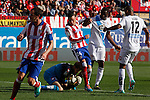 Atletico de Madrid´s Diego Godin and Gimenez and Deportivo de la Coruña´s Diakhite and goalkeeper Fabricio during 2014-15 La Liga match between Atletico de Madrid and Deportivo de la Coruña at Vicente Calderon stadium in Madrid, Spain. November 30, 2014. (ALTERPHOTOS/Victor Blanco)