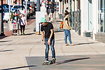 TORRINGTON, CT. 12 January 2020-011220BS10 - Brandon Beardsley of Torrington takes advantage of the warm and unseasonable temperatures by riding his skateboard down the sidewalk in front of the Warner Theater in Torrington on Sunday. Bill Shettle Republican-American