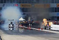 Apr. 28, 2013; Baytown, TX, USA: NHRA top fuel dragster driver Spencer Massey (right) explodes an engine alongside Brandon Bernstein during the Spring Nationals at Royal Purple Raceway. Mandatory Credit: Mark J. Rebilas-