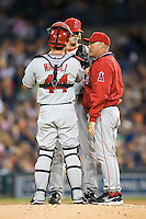 Los Angeles Angels' pitching coach Mike Butcher has a chat with starting pitcher Jered Weaver (36) and catcher Mike Napoli (44) at Comerica Park in Detroit, MI, Sunday, April 27, 2008.