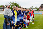 Ragnar the Viking, Yorkshire's mascot, and the Yorkshire players listen to the anthems. Yorkshire v Parishes of Jersey, CONIFA Heritage Cup, Ingfield Stadium, Ossett. Yorkshire's first competitive game. The Yorkshire International Football Association was formed in 2017 and accepted by CONIFA in 2018. Their first competative fixture saw them host Parishes of Jersey in the Heritage Cup at Ingfield stadium in Ossett. Yorkshire won 1-0 with a 93 minute goal in front of 521 people. Photo by Paul Thompson