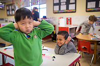 NWA Democrat-Gazette/CHARLIE KAIJO Leonardo Hu, 4 (from left), and Austin Moss, 4, cover their ears as a vacuum cleaner runs in the background, Monday, February 12, 2018 at Helen R. Walton Children&acirc;&euro;&trade;s Enrichment Center in Bentonville. <br />