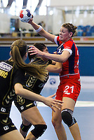 30 MAY 2012 - LONDON, GBR - Kathryn Fudge (GBR) of Great Britain (right, in red and blue) finds her path to goal blocked by the Montenegro defence during the women's 2012 European Handball Championship qualification match at the National Sports Centre in Crystal Palace, Great Britain (PHOTO (C) 2012 NIGEL FARROW)