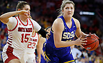 SIOUX FALLS, SD - MARCH 10: Paiton Burckhard #33 of the South Dakota State Jackrabbits drives past Taylor Frederick #15 of the South Dakota Coyotes during the women's championship game at the 2020 Summit League Basketball Tournament in Sioux Falls, SD. (Photo by Richard Carlson/Inertia)