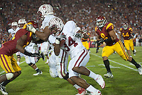 LOS ANGELES, CA - October 29, 2011:  After taking a lateral from Ty Montgomery, Jeremy Steward rushes for additional yards in the first overtime during Stanford's Pac-12 victory over the USC Trojans.  Stanford won in triple overtime, 56 -48, and extended its winning streak to 16 games.