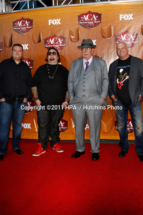 LOS ANGELES - DEC 5:  Corey Harrison, Austin 'Chumlee' Russell, Richard Harrison and Rick Harrison of 'Pawn Stars' arrives at the American Country Awards 2011 at MGM Grand Garden Arena on December 5, 2011 in Las Vegas, NV