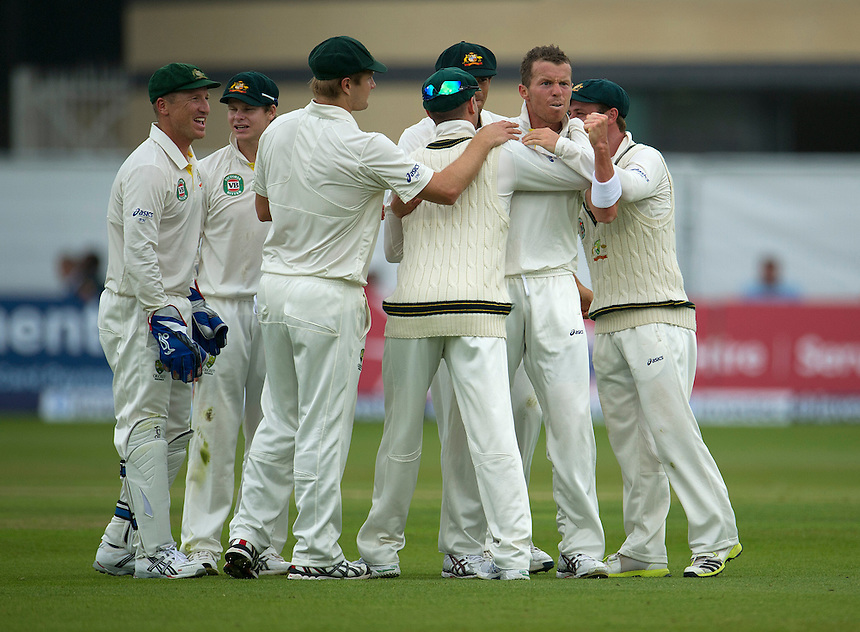 Australia's Peter Siddle (2nd from right) celebrates taking the wicket of England's Jonathan Trott - IJL Trott b Siddle 48<br /> <br />  (Photo by Stephen White/CameraSport) <br /> <br /> International Cricket - First Investec Ashes Test Match - England v Australia - Day 1 - Wednesday 10th July 2013 - Trent Bridge - Nottingham<br /> <br /> &copy; CameraSport - 43 Linden Ave. Countesthorpe. Leicester. England. LE8 5PG - Tel: +44 (0) 116 277 4147 - admin@camerasport.com - www.camerasport.com