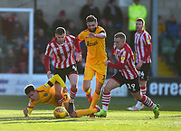 Lincoln City's Michael O'Connor, 2nd left and Danny Rowe, right bring the ball out of defence under pressure from Northampton Town's Shaun McWilliams, left, and Jordan Turnbull<br /> <br /> Photographer Andrew Vaughan/CameraSport<br /> <br /> The EFL Sky Bet League Two - Lincoln City v Northampton Town - Saturday 9th February 2019 - Sincil Bank - Lincoln<br /> <br /> World Copyright &copy; 2019 CameraSport. All rights reserved. 43 Linden Ave. Countesthorpe. Leicester. England. LE8 5PG - Tel: +44 (0) 116 277 4147 - admin@camerasport.com - www.camerasport.com