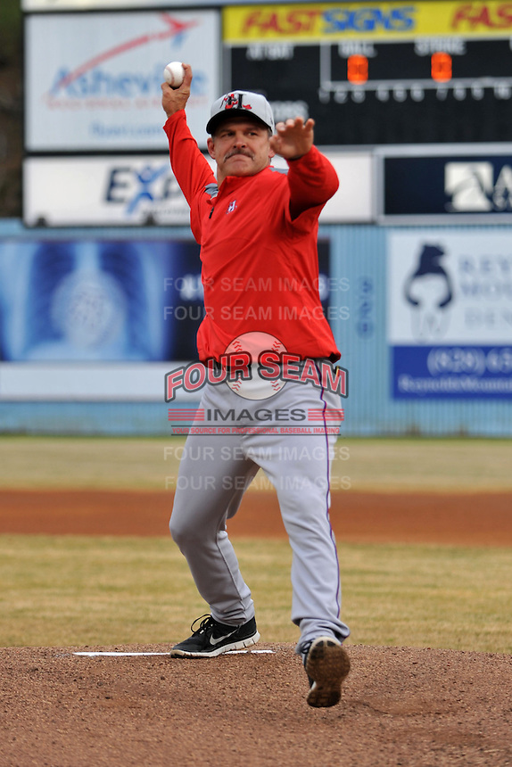 Former Asheville Tourists manager and current Texas Rangers roving instructor Joe Mikulik throws out the first pitch before a game between the Hickory Crawdads and the Asheville Tourists at McCormick Field on April 17, 2013 in Asheville, North Carolina. The Crawdads won the game 6-5. (Tony Farlow/Four Seam Images).
