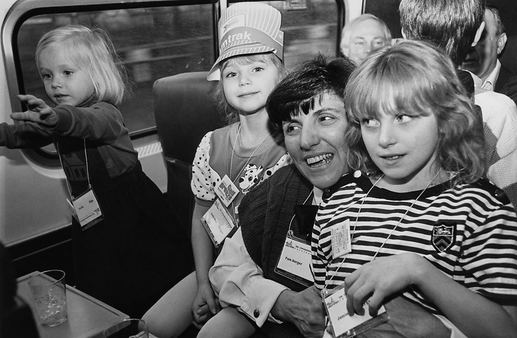 Meg Upton (age 3), Julie Herger (age 5), wearing Amtrak Engineer Cap, Pam Herger and Jamie Herger (age 7), Rep. Jim Leach, R- Iowa, in background on the Train ride to Princeton for Republican Retreat on March 14, 1991. (Photo by Laura Patterson/CQ Roll Call via Getty Images)