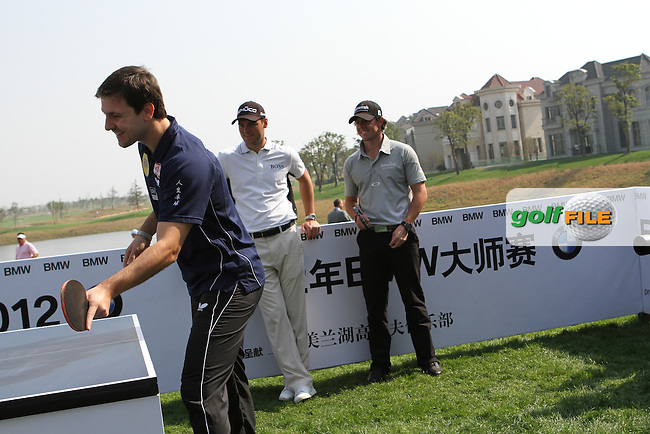 Table tennis star Timo Boll challenges Martin Kaymer (GER), Rory McIlroy (NIR) and Wu A Shun (CHN) to play table tennis ahead of the BMW Masters 2012 at Lake Malaren Golf Club, Shanghai, China, Tuesday 23/10/12...(Photo Jenny Matthews/www.golffile.ie)
