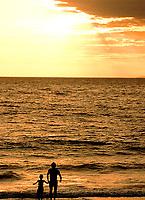 Father and sun share the sunset, Maui, Hawaii