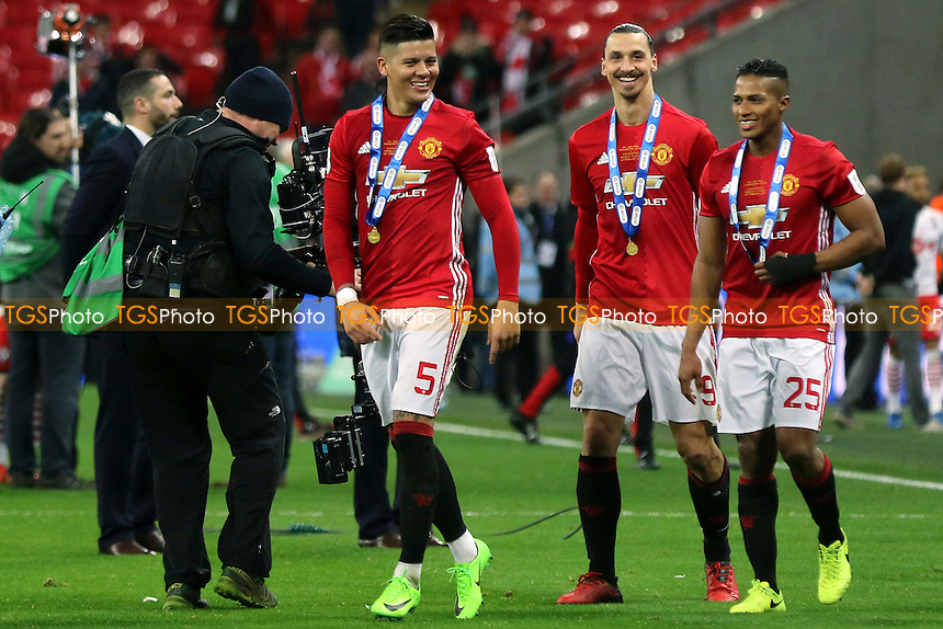 All smiles for Manchester United's Marcos Rojo, Zlatan Ibrahimovic and Antonio Valencia as they celebrate winning the EFL Cup during Manchester United vs Southampton, EFL Cup Final Football at Wembley Stadium on 26th February 2017