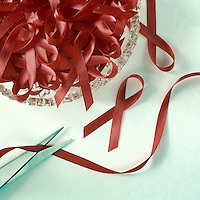 Making aids ribbons, red ribbon, scissors