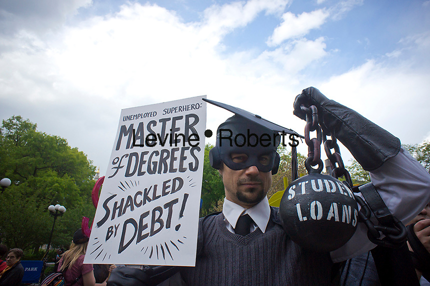 Gan Golan, in his 'Master of Degrees costume, joins Occupy Wall Street protesters, students and supporters at a rally in Union Square Park in New York on Wednesday, April 25, 2012, the day that student loan debt is expected to reach $1 trillion. The protest, part of the 1T Day movement, proposes that the government should cover higher education costs, loans, if necessary, to be made at zero interest, colleges open their books and a one-time debt forgiveness.   (© Richard B. Levine)