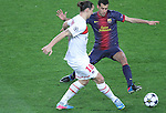 10.04.2013 Barcelona, Spain. Champions league Quarter-final row 2. Picture show Ibrahimovic (L) and Sergio Busquets (R) in action during match between FC Barcelona against Paris SG at Camp Nou