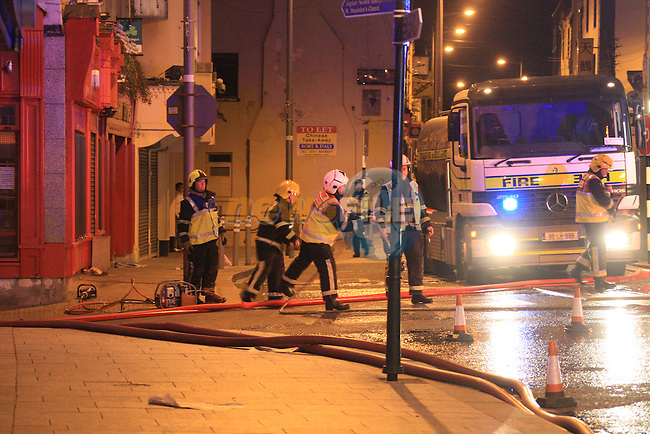 Three Units of Drogheda Fire Service backed up by units from Dunleer and Dundalk tackled the fire at the WEAVERS bar in west street in Drogheda for over 7 hours. The alarm was raised shortly before 3am and it took the fire service over five hours to bring it under control..Picture: Fran Caffrey/ www.newsfile.ie .