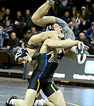 SIOUX FALLS, SD - DECEMBER 7:  Brance Simms from South Dakota State lifts Morgan Engbrecht from Augustana in their 133 pound match Sunday afternoon at the Sanford Pentagon.  (Photo by Dave Eggen/inertia)