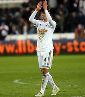 SWANSEA, WALES - FEBRUARY 07: Goal scorer Ki Sung Yueng of Swansea applauds home supporters after the Premier League match between Swansea City and Sunderland AFC at Liberty Stadium on February 7, 2015 in Swansea, Wales.