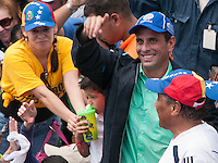 Venezuela: Puerto Ordaz,20/09/11 .Venezuelan opposition candidate Henrique Capriles, wearing a jacket of the steel worker,speechs to supporters during a rally in the neighborhood Unare, Puerto Ordaz, south of Venezuela..Carlos Hernandez/Archivolatino