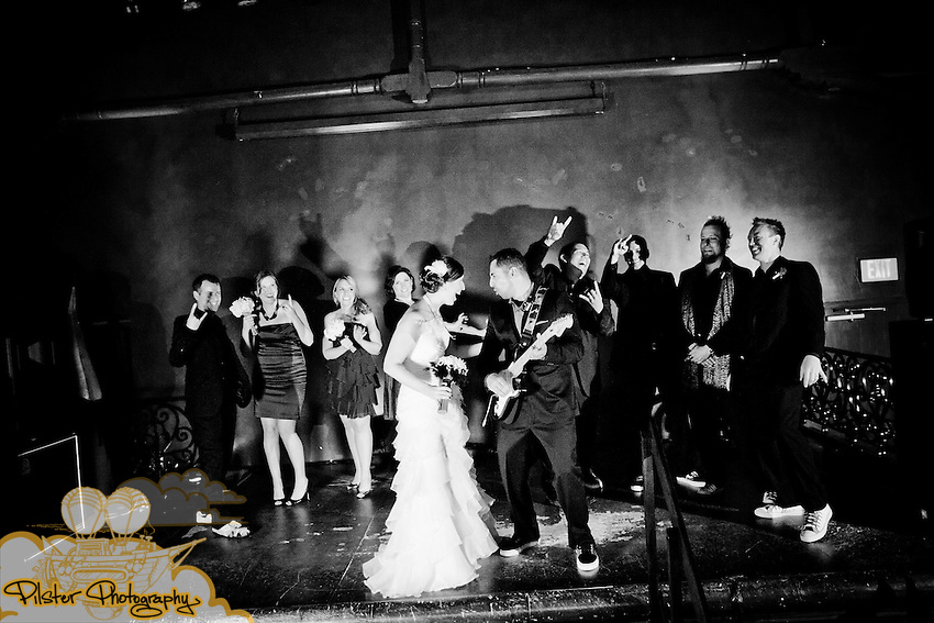Amanda Adler and Derrick Paladino during their wedding on Sunday, September 5, 2011, at Ceviche Tapas Bar and Restaurant in Orlando, Florida. They got ready at the Embassy Suites. The entire wedding had a Rock n' Roll theme. (Chad Pilster for Pilster Photography http://www.PilsterPhotography.net)