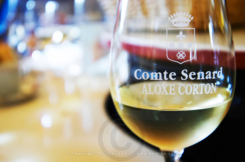 glass of corton domaine comte senard aloxe-corton cote de beaune burgundy france